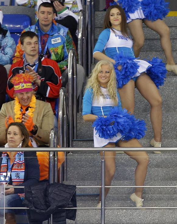 Sochi Olympic cheerleads perform in the aisles during the women's ice hockey game between USA and Finland at the Shayba Arena during the 2014 Winter Olympics, Saturday, Feb. 8, 2014, in Sochi, Russia. (AP Photo/Matt Slocum)