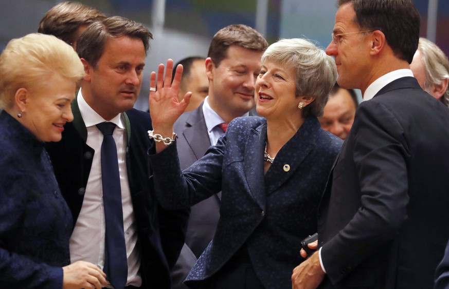 British Prime Minister Theresa May, center, speaks with Dutch Prime Minister Mark Rutte, right, and /Lithuanian President Dalia Grybauskaite, left, during a round table meeting at an EU summit in Brussels, Thursday, March 21, 2019. British Prime Minister Theresa May is trying to persuade European Union leaders to delay Brexit by up to three months, just eight days before Britain is scheduled to leave the bloc. (AP Photo/Frank Augstein)