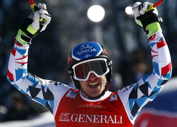 Austria's Matthias Mayer celebrates at the finish area of an alpine ski, men's World Cup Super G, in Kitzbuehel, Austria, Friday, Jan. 20, 2017. (AP Photo/Giovanni Auletta)