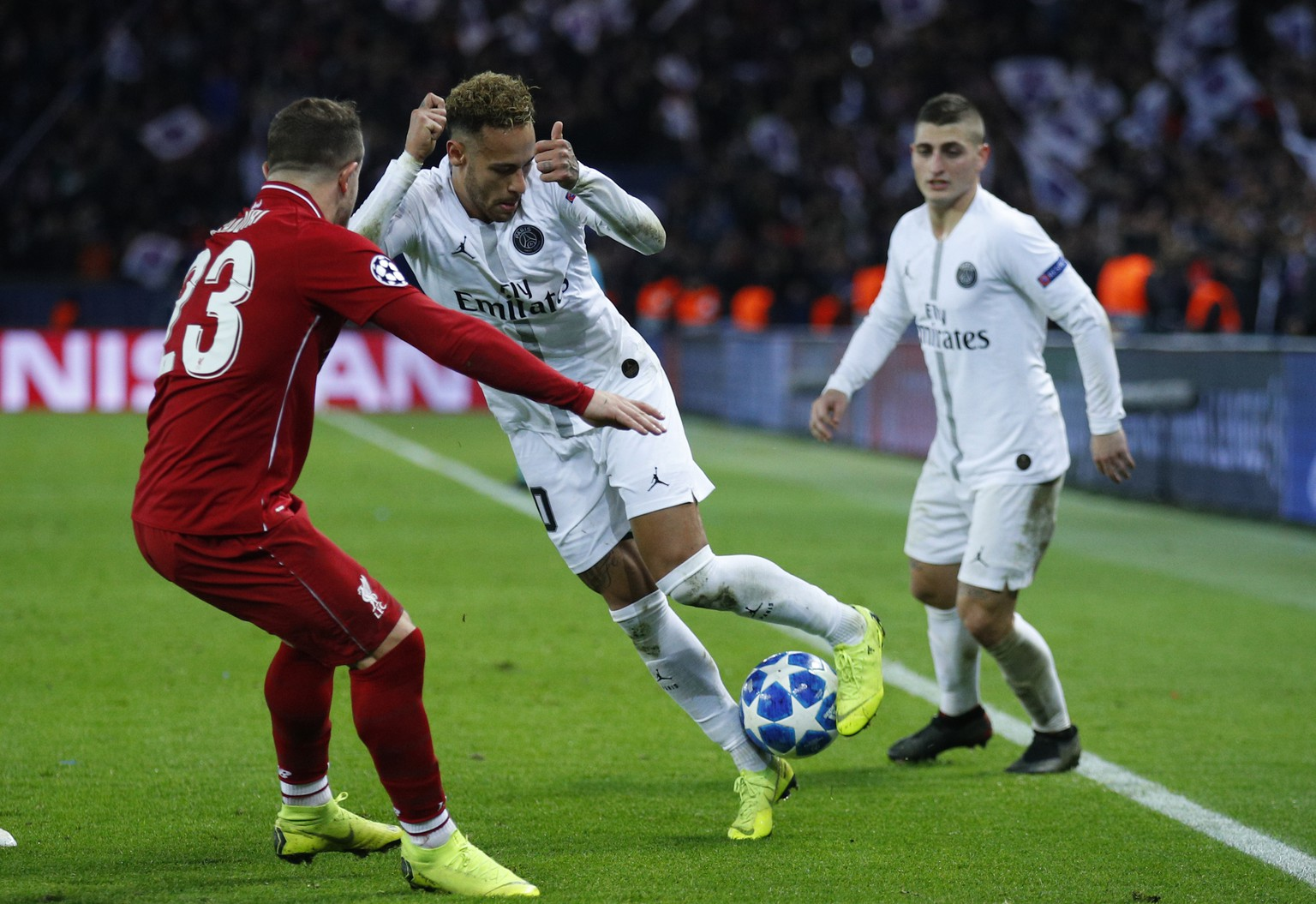 PSG forward Neymar, right, challenges for the ball with Liverpool midfielder Xherdan Shaqiri during a Champions League Group C soccer match between Paris Saint Germain and Liverpool at the Parc des Princes stadium in Paris, Wednesday, Nov. 28, 2018. (AP Photo/Francois Mori)