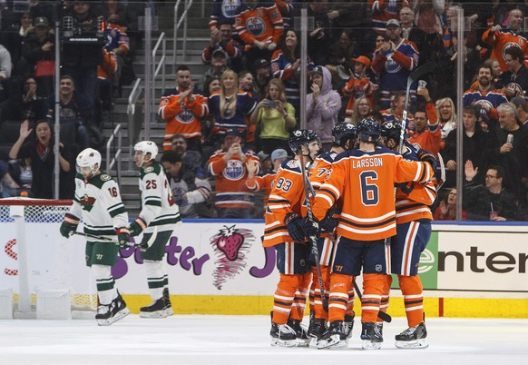 Edmonton Oilers celebrate a goal against the Minnesota Wild during the third period in an NHL hockey game in Edmonton, Alberta, Friday, Dec. 7, 2018. (Jason Franson/The Canadian Press via AP)