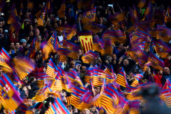epa07510900 FC Barcelona's fans wave flags during the UEFA Champions League quarter-final second leg match between FC Barcelona and Manchester United at Camp Nou stadium in Barcelona, Catalonia, Spain, 16 April 2019.  EPA/Alejandro Garcia