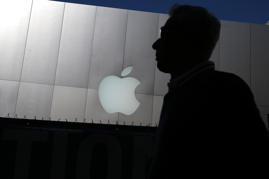 SAN FRANCISCO, CA - APRIL 23:  A person walks by an Apple Store on April 23, 2013 in San Francisco, California.  Analysts believe that Apple Inc. will report their first quarterly loss in nearly a decade as the company prepares to report first quarter earnings today after the closing bell. (Photo by Justin Sullivan/Getty Images)