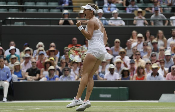Belinda Bencic of Switzerland celebrates breaking the serve of Angelique Kerber of Germany during their women's singles match on the seventh day at the Wimbledon Tennis Championships in London, Monday July 9, 2018. (AP Photo/Kirsty Wigglesworth)