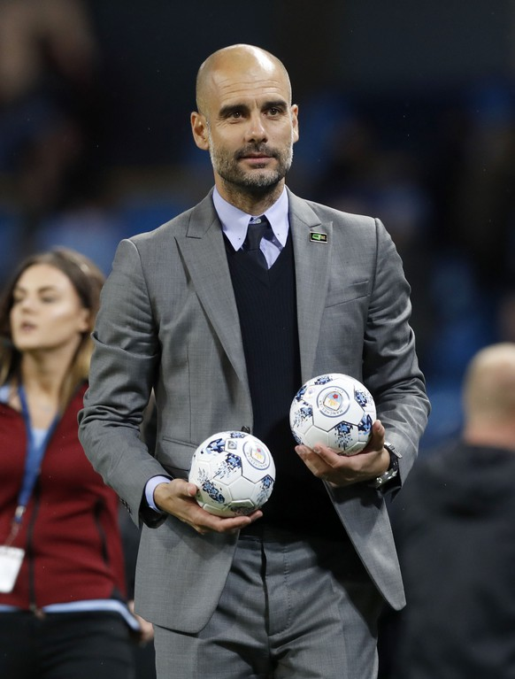 Manchester City manager Pep Guardiola walks on the field after the final whistle during the English Premier League soccer match against West Bromwich Albion at the Etihad Stadium, Manchester, England, Tuesday, May 16, 2017. (Martin Rickett/PA via AP)