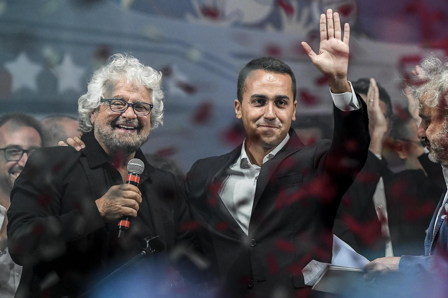 Five Stars Movement newly elected leader and candidate to Italian premiership Luigi Di Mailo, right, and movement founder Beppe Grillo, left, talk from the stage during a movement's meeting in Rimini, Italy, Saturday, Sept. 23, 2017. Italy's anti-establishment 5-Star Movement opened a new phase in its quest for the country's premiership Saturday by choosing Luigi Di Maio as its candidate and party leader to take the reins from Grillo. (Filippo Pruccoli/ANSA via AP)