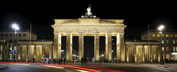 The Brandenburger Tor gate is seen before the Earth Hour in Berlin, Germany March 19, 2016. Picture taken with long-time exposure.     REUTERS/Fabrizio Bensch