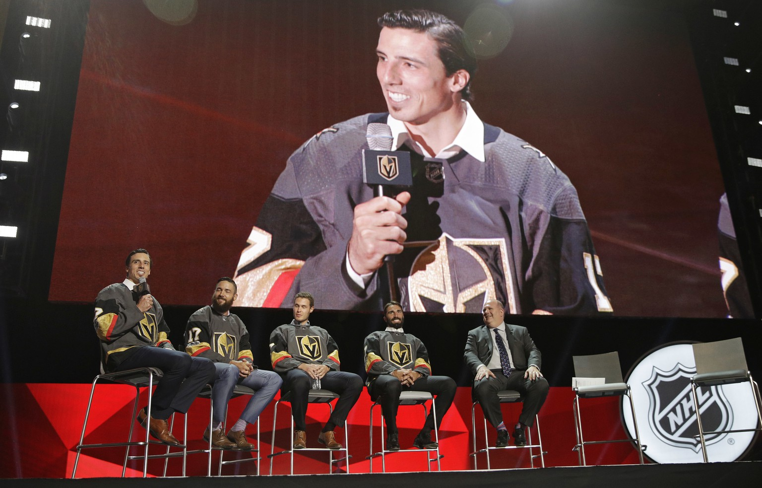 From left, Vegas Golden Knights' Marc-Andre Fleury, Deryk Engelland, Brayden McNabb and Jason Garrison sit on stage during an event following the NHL expansion draft, Wednesday, June 21, 2017, in Las Vegas. Fleury was picked by the Golden Knights in the NHL expansion draft. (AP Photo/John Locher)