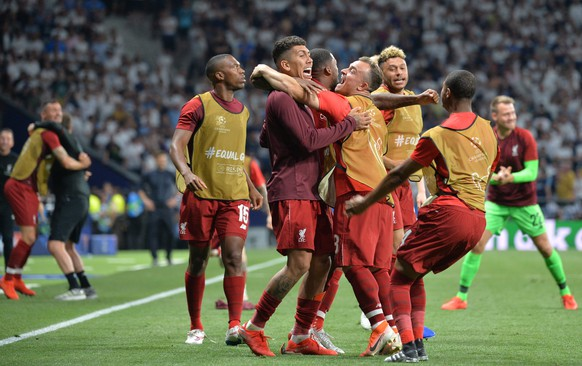 epa07618926 Players of Liverpool FC celebrate  the 2-0 lead during the UEFA Champions League final between Tottenham Hotspur and Liverpool FC at the Wanda Metropolitano stadium in Madrid, Spain, 01 June 2019.  EPA/PETER POWELL