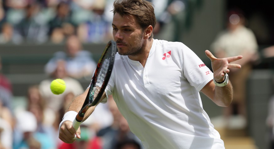 Stan Wawrinka of Switzerland plays a return to Taylor Fritz of the U.S during their men's singles match on day two of the Wimbledon Tennis Championships in London, Tuesday, June 28, 2016. (AP Photo/Tim Ireland)