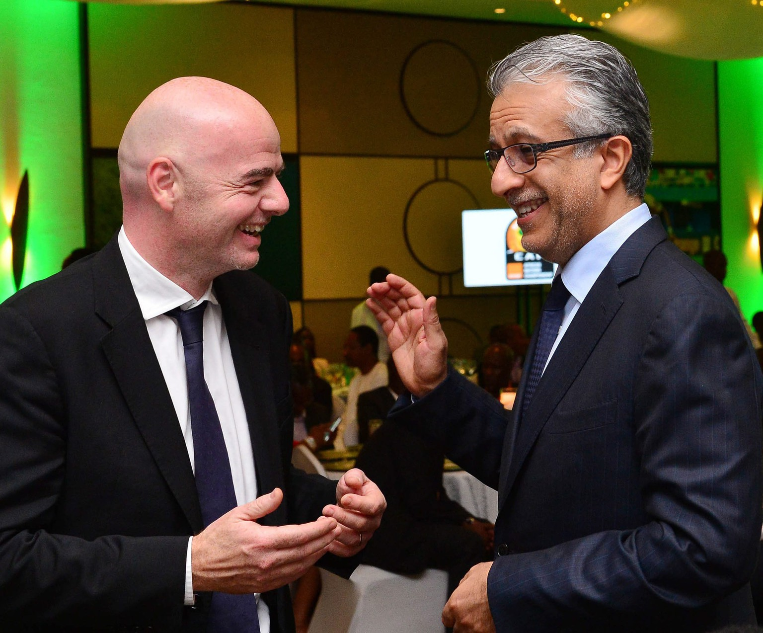 epa05145308 FIFA Presidential candidates Gianni Infantino (L) and Shaikh Salman Al Khalifa during the CAF LOC Dinner at the Serena Hotel in Kigali, Rwanda, 05 February 2016.  EPA/GAVIN BARKER UK AND IRELAND OUT