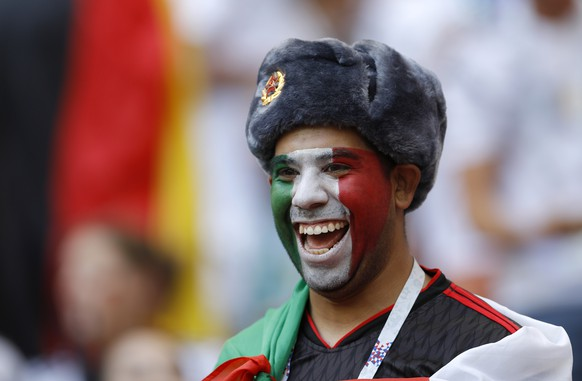 A supporter of Mexico smiles on the stands before the group F match between Germany and Mexico at the 2018 soccer World Cup in the Luzhniki Stadium in Moscow, Russia, Sunday, June 17, 2018. (AP Photo/Victor R. Caivano)