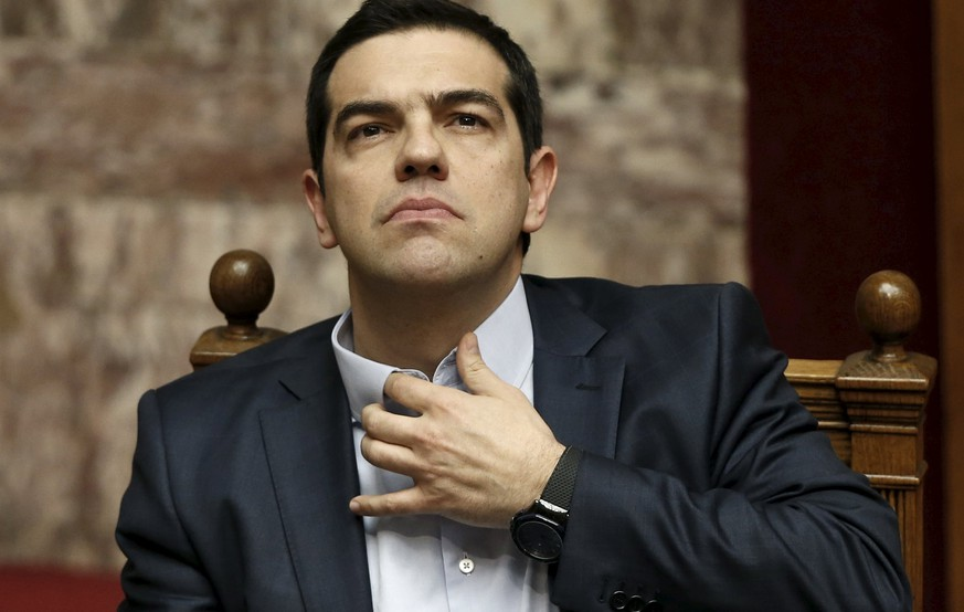 Greek Prime Minister Alexis Tsipras gestures before his speech during a parliament session in Athens March 30, 2015. Tsipras said on Monday his government was ready to implement a deal struck with euro zone lenders in February but would not do it at any cost. REUTERS/Alkis Konstantinidis