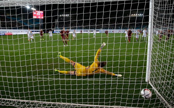 Liechtenstein's goalkeeper Peter Jehle misses the penalty shot by Russia's Dmitri Kombarov, center left, during their Euro 2016 qualifying soccer match at Arena Khimki stadium in Moscow, Russia, Monday, Sept. 8, 2014. (AP Photo/Pavel Golovkin)