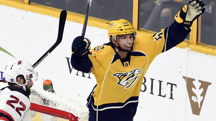 Nashville Predators left wing Kevin Fiala, right, of Czech Republic, celebrates after scoring a goal against the New Jersey Devils during the first period of an NHL hockey game, Saturday, Dec. 3, 2016, in Nashville, Tenn. (AP Photo/Mark Zaleski)