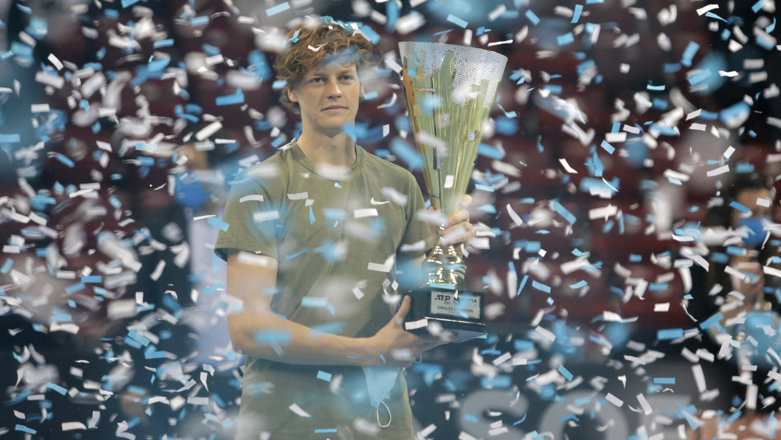 Italy's Jannik Sinner holds the trophy after winning the final match of the 2020 Sofia Open ATP 250 tennis tournament against Canada's Vasek Pospisil, in Sofia, Bulgaria, Saturday, Nov. 14, 2020. (AP Photo)