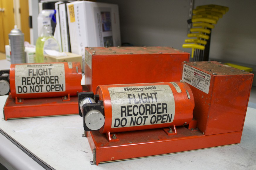 This image released by the National Transportation Safety Board Sunday, July 7, 2013, shows the flight data recorder, left, and the cockpit voice recorder  from the Boeing 777 Asiana Airlines Flight 214, at the recorders laboratory at the NTSB's Washington headquarters in Washington. The  Asiana flight crashed upon landing Saturday, July 6, at San Francisco International Airport, and investigators took the flight recorders to the recorders laboratory at the NTSB's Washington headquarters overnight to begin examining its contents for clues to the last moments of the flight, officials said.   (AP Photo/NTSB)