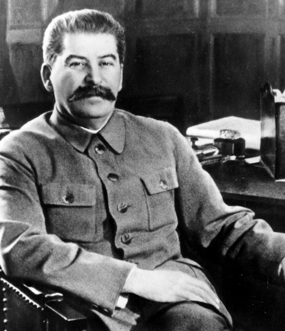 ** FILE ** Josef Stalin, secretary-general of the Communist Party of the Soviet Union and premier of the Soviet state, poses at his desk in the Kremlin, Moscow, in an election photo issued in Feb. 1950. . Ninety years after he was executed, Czar Nicholas II is leading a tight race to be named the greatest Russian in history. His closest competitors? Soviet dictator Josef Stalin and Vladimir Lenin, the founder of the Soviet state that killed the last czar and his entire family. The contest, sponsored by state-owned Rossiya television, is a Russian version of the 2002 BBC show