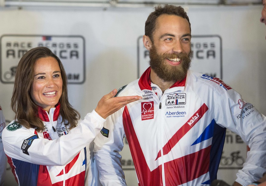 epa04270398 British socialite Pippa Middleton (L) and her brother James Middleton (R) participate in a post-race interview after finishing the Race Across America bike race in Annapolis, Maryland, USA, 21 June 2014. Middleton was part of the Michael Matthews Foundation team that traveled 3,000 miles across the United States.  EPA/DREW ANGERER