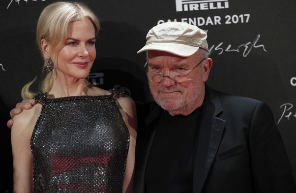 Photographer Peter Lindbergh and Nicole Kidman pose during a photocall to unveil the Pirelli 2017 calendar by Peter Lindbergh in Paris, Tuesday, Nov. 29, 2016. (AP Photo/Christophe Ena)