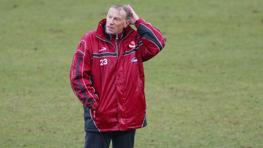 FC Energie Cottbus coach Eduard Geyer reacts after the German first division soccer match between FC Energie Cottbus and VFB Stuttgart in Cottbus on Saturday, April 5, 2003. Cottbus lost by 2-3 goals and will leave the first division in next season. (AP Photo/ Jan Bauer)