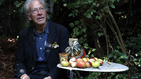 Austrian author Peter Handke poses for a photo in his garden at his house in Chaville near Paris, Thursday, Oct. 10, 2019. Handke was awarded the 2019 Nobel Prize in literature earlier Thursday. (AP Photo/Francois Mori)