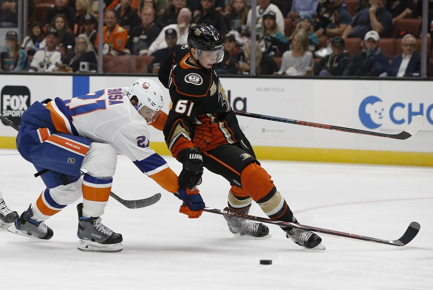 New York Islanders defenseman Luca Sbisa, left, of Italy, defends, as Anaheim Ducks right wing Troy Terry overskates the puck during the second period of an NHL hockey game in Anaheim, Calif., Wednesday, Oct. 17, 2018. (AP Photo/Alex Gallardo)