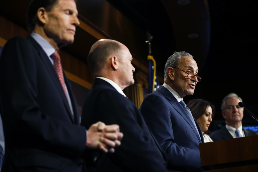 Democratic leader Sen. Chuck Schumer, D-N.Y., talk to reporters about the impeachment trial of President Donald Trump on charges of abuse of power and obstruction of Congress, at the Capitol in Washington, Thursday, Jan. 16, 2020. With Schumer from left is Sen. Richard Blumenthal, D-Conn., Sen. Chris Coons, D-Del., Sen. Kamala Harris, D-Calif., and Sen. Chris Van Hollen, D-Md. (AP Photo/Matt Rourke) John Roberts