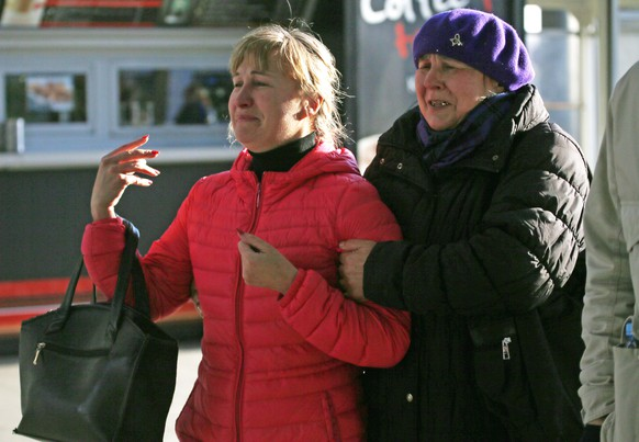 Relatives of the victims of a Russian airliner with 217 passengers and seven crew aboard has crashed, react as they gather at Pulkovo airport in St.Petersburg, Russia, Saturday, Oct. 31, 2015. Russia's civil air agency is expected to have a news conference shortly to talk about the Russian Metrojet passenger plane that Egyptian authorities say has crashed in Egypt's Sinai peninsula. (AP Photo/Dmitry Lovetsky)