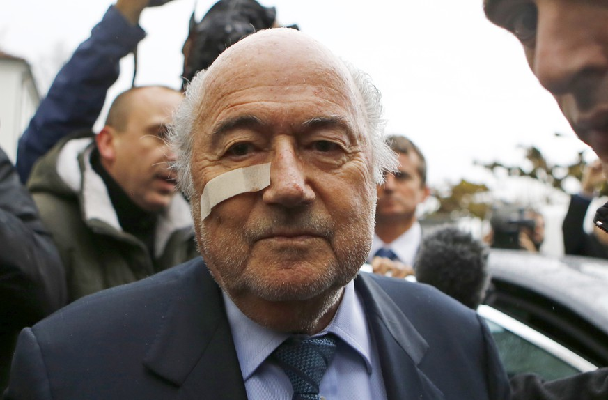 FILE - In this Dec. 21, 2015 file photo, FIFA President Sepp Blatter arrives for a news conference in Zurich, Switzerland, after he was banned for 8 years from all football-related activities over a $2 million payment by FIFA to Michel Platini, the president of European soccer's ruling body UEFA. The Sepp Blatter era at FIFA is set to finally end Friday, Feb. 26, 2016,  when soccer's scandal-scarred world body picks a new president after nine months of crisis. (AP Photo/Matthias Schrader, File)