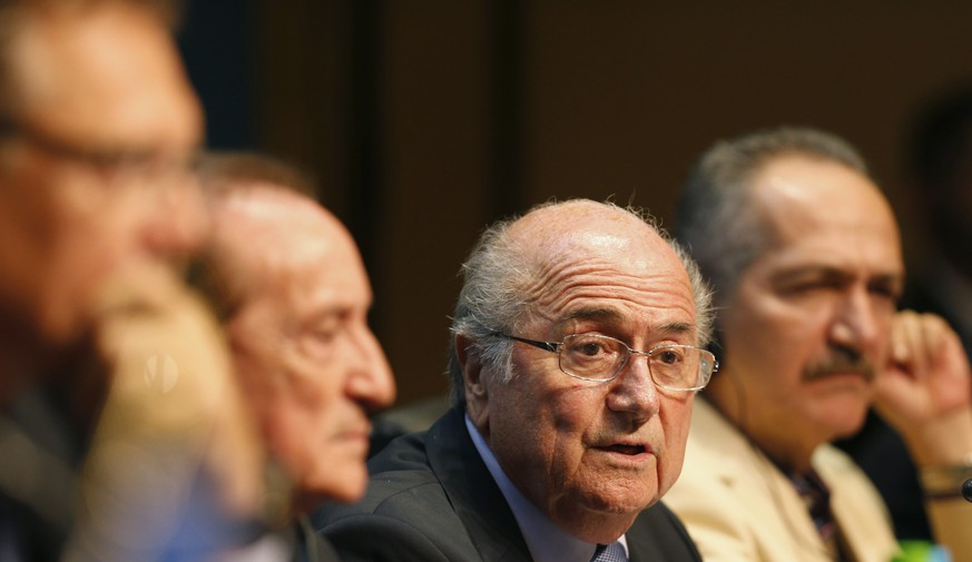 FIFA President Sepp Blatter (2nd R) attends a media conference in Sao Paulo June 5, 2014. The 2014 World Cup will be held in 12 cities in Brazil from June 12 to July 13. REUTERS/Paulo Whitaker (BRAZIL - Tags: SPORT SOCCER WORLD CUP)