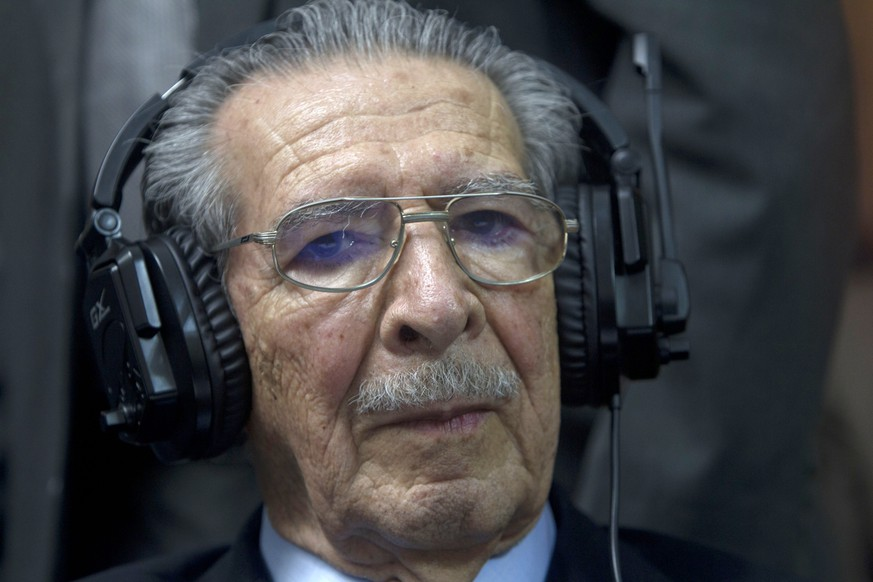 FILE - In this May 10, 2013 file photo, Guatemala's former dictator Jose Efrain Rios Montt wears headphones as he listens to the verdict in his genocide trial in Guatemala City. A Guatemalan court has ruled that Rios Montt be hospitalized for medical and psychological evaluation to determine if he is fit to stand trial. The 89-year-old former general faces charges of genocide for the killing of 1,771 Mayan Ixil people by security forces during his 1982-83 regime. He was convicted in 2013 and sentenced to 80 years, but the verdict was overturned and a new trial ordered. (AP Photo/Moises Castilo, File)