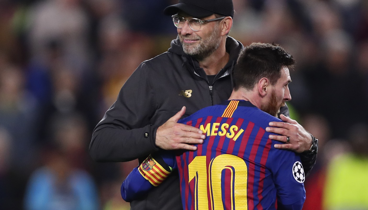 Barcelona's Lionel Messi, who scored two of the team's three goals, hugs Liverpool coach Juergen Klopp after the Champions League semifinal first leg soccer match between FC Barcelona and Liverpool at the Camp Nou stadium in Barcelona, Spain, Wednesday, May 1, 2019. (AP Photo/Manu Fernandez)