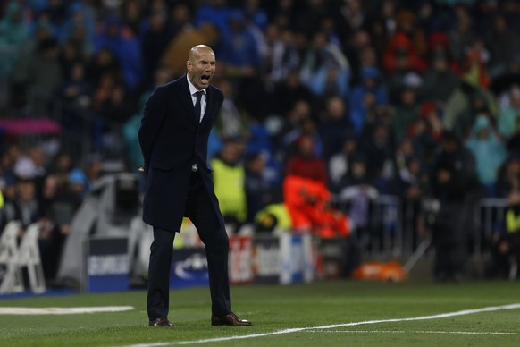Real Madrid's head coach Zinedine Zidane reacts during the Champions League 2nd leg quarterfinal soccer match between Real Madrid and VfL Wolfsburg at the Santiago Bernabeu stadium in Madrid, Spain, Tuesday April 12, 2016. (AP Photo/Francisco Seco)