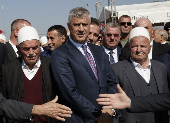 epa07071900 President of the Republic of Kosovo Hashim Thaci (C) attends the inauguration ceremony of the martyrs memorial in the village of Marina, Kosovo, 05 October 2018. Some 157 martyrs killed during the 1998-99 war between Serb security forces and Albanian guerrillas are buried at martyrs memorial in the Kosovo's central village of Marina.  EPA/VALDRIN XHEMAJ