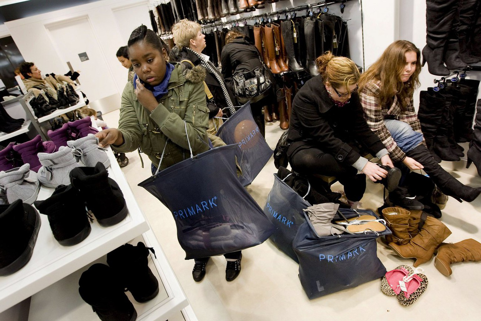epa01565551 Customers arrive after the first Prmark store opened in Rotterdam, Netherlands on 01 December 2008.  Primark sells 'trendy, afordable clothing', and was established in 1969 in Great Britain. The store currently has stores in Ireland, Great Britain, Spain and, from 01 December, the Netherlands.  EPA/ED OUDENAARDEN