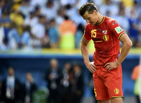 Belgium's Daniel Van Buyten reacts after the team's 2014 World Cup quarter-finals against Argentina at the Brasilia national stadium in Brasilia July 5, 2014. REUTERS/Dylan Martinez (BRAZIL  - Tags: SOCCER SPORT WORLD CUP)