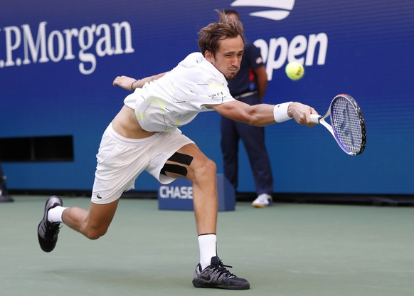 epa07815505 Daniil Medvedev of Russia hits a return to Stan Wawrinka of Switzerland  during their quarter-finals round match on the ninth day of the US Open Tennis Championships the USTA National Tennis Center in Flushing Meadows, New York, USA, 03 September 2019. The US Open runs from 26 August through 08 September.  EPA/JOHN G. MABANGLO