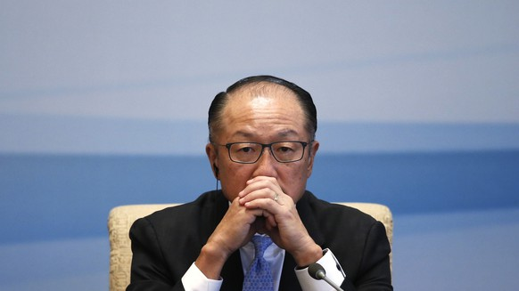 FILE- In this Sept. 12, 2017, file photo World Bank President Jim Yong Kim pauses during a joint press conference for the 1+6 Roundtable Dialogue at the Diaoyutai State Guesthouse in Beijing. Kim says he is resigning at the end of January. Kim's unexpected departure nearly three years before his term was set to expire, is likely to set off a fierce battle between the Trump administration and other countries who have complained about the influence the United States exerts over the World Bank(AP Photo/Andy Wong, File)