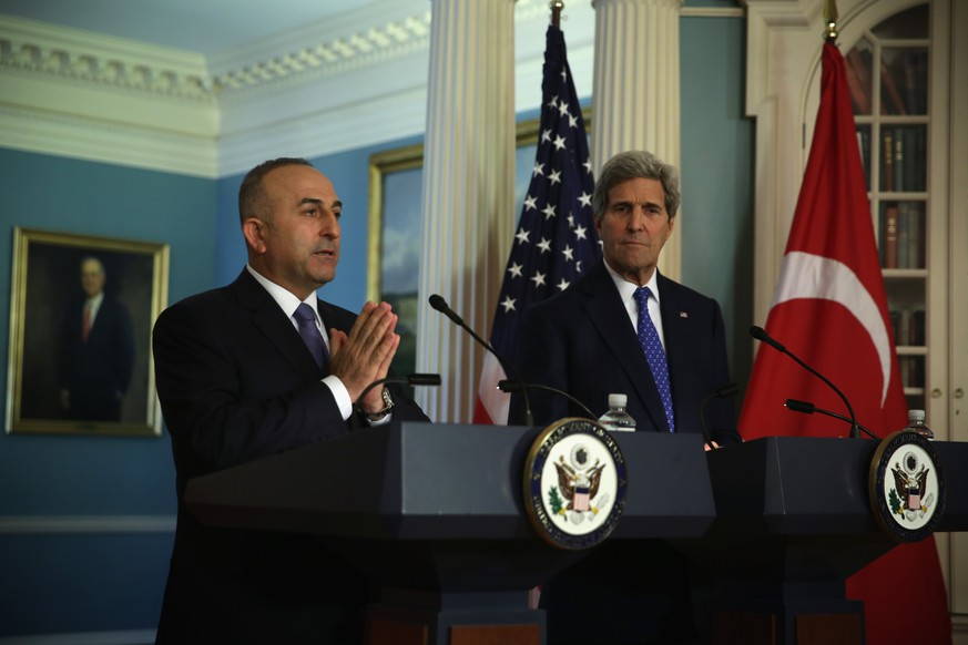 WASHINGTON, DC - APRIL 21:  U.S. Secretary of State John Kerry (R) listens as Turkish Minister of Foreign Affairs Mevlut Cavusoglu (L) makes remarks to members of the media prior to a meeting at the State Department April 21, 2015 in Washington, DC. Kerry and Cavusoglu were expected to discuss a number of topics, including the fight against ISIS.  (Photo by Alex Wong/Getty Images)