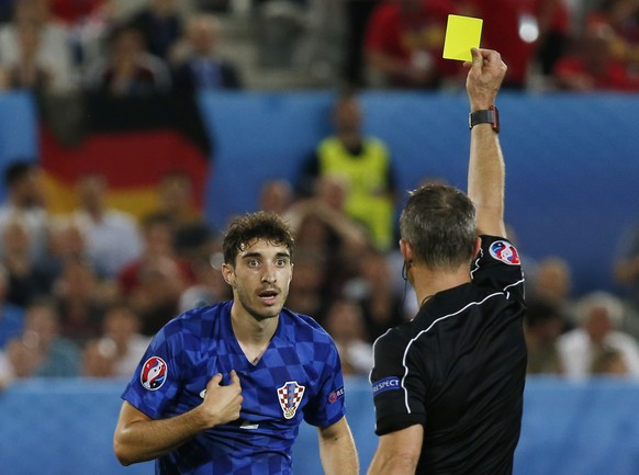 Football Soccer - Croatia v Spain - EURO 2016 - Group D - Stade de Bordeaux, Bordeaux, France - 21/6/16Croatia's Sime Vrsaljko is booked by referee Bjorn KuipersREUTERS/Sergio Perez  Livepic