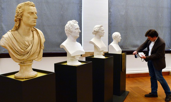 epa05268403 A man takes a picture of busts portraying Germans  (L-R) poet Friedrich Schiller, philosopher Johann Gottlieb Fichte, philosopher Friedrich Wilhelm Joseph Schelling and philosopher Georg Wilhelm Friedrich Hegel during a preview of the Thuringian state exhibition 'The Ernestines - A Dynasty Shapes Europe' at the New Museum in Weimar, Germany, 20 April 2016. Exhibits from the Protestant Reformation in the 16th century to the end of the German Empire in 1918 will be showcased in Weimar and Gotha. The exhibition will run from 24 April to 28 August.  EPA/MARTIN SCHUTT