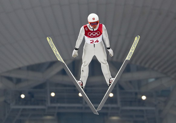 Tim Hug, of Switzerland, soars through the air during the trial jump in the nordic combined competition at the 2018 Winter Olympics in Pyeongchang, South Korea, Wednesday, Feb. 14, 2018. (AP Photo/Matthias Schrader)
