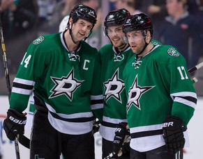 Mar 6, 2014; Dallas, TX, USA; Dallas Stars center Tyler Seguin (91) celebrates his hat trick with left wing Jamie Benn (14) and center Rich Peverley (17) against the Vancouver Canucks at the American Airlines Center. The Stars won 6-1. Mandatory Credit: Jerome Miron-USA TODAY Sports