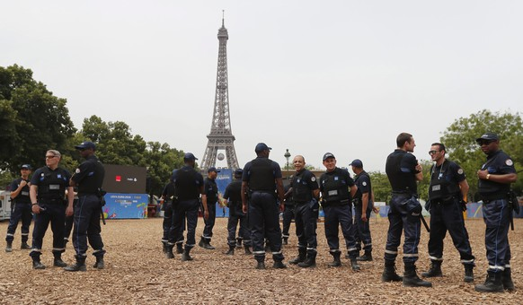 epa05355072 Municipal police officers gather inside the UEFA EURO 2016 Fan Zone, near the Eiffel tower in Paris, France, 10 June 2016. The UEFA EURO 2016 soccer tournament kicks off on 10 June with the opening match between France and Romania at the Stade de France.  EPA/IAN LANGSDON