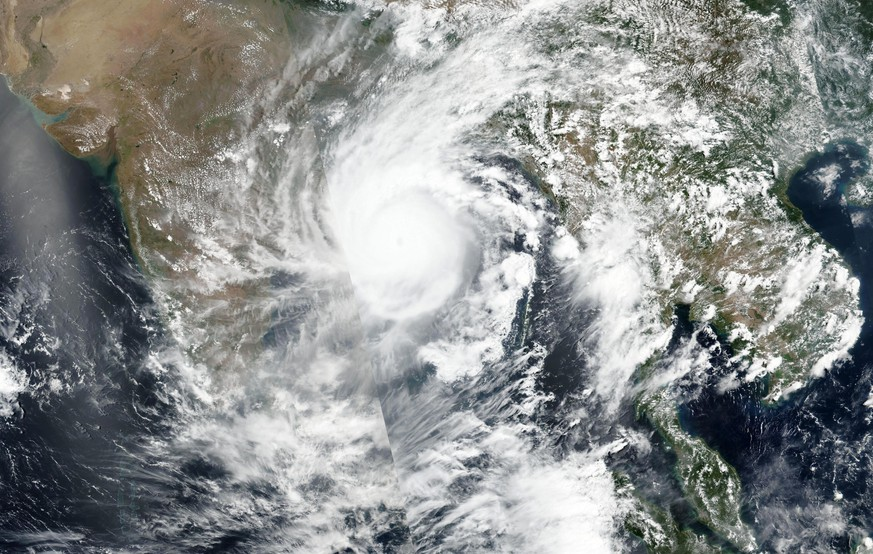 This Tuesday, May 19, 2020, satellite image released by NASA shows Cyclone Amphan over the Bay of Bengal in India. The powerful storm is expected to make landfall on Wednesday afternoon, May 20, 2020, and forecasters are warning of extensive damage from high winds, heavy rainfall, tidal waves and some flooding in crowded cities like Kolkata. (NASA Worldview, Earth Observing System Data and Information System (EOSDIS) via AP)
