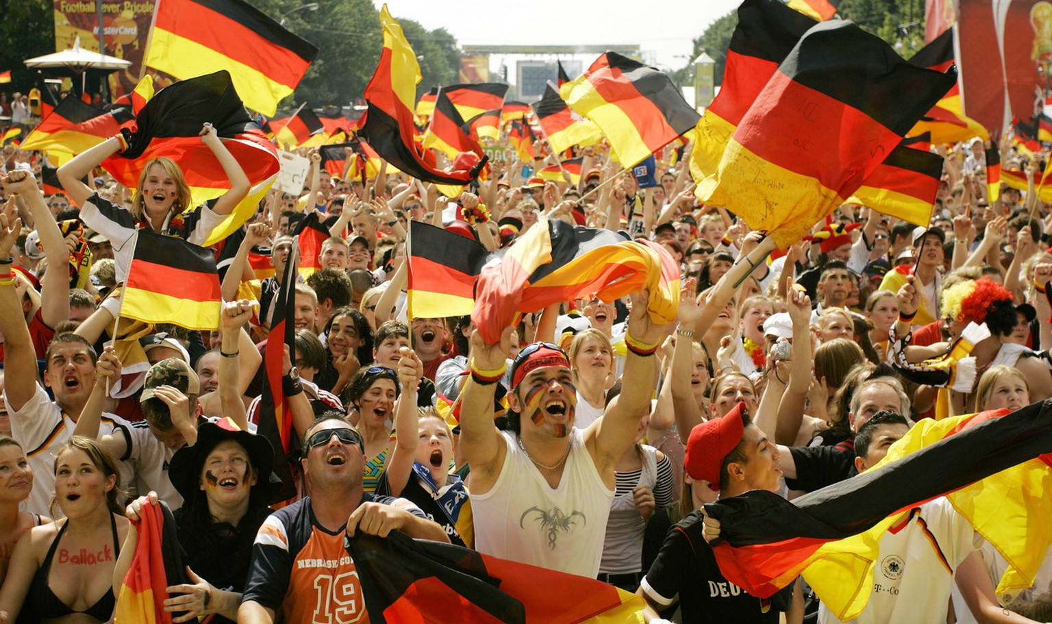 German soccer fans cheer as Germany scores the first goal during the World Cup soccer match Germany against Ecuador as they watch the game on a giant TV screen at the public viewing area in Berlin, Tuesday, June 20, 2006. The other teams in Group A are Costa Rica and Poland.  (AP Photo/Franka Bruns) ** zu unserem Paket 'DEU FUSSBALL WM RUECKBLICK' **