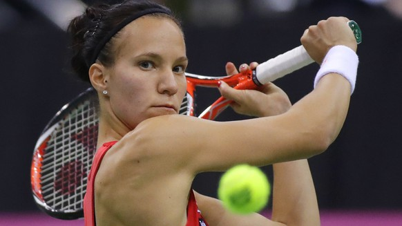 FILE - In this file photo dated Sunday April 23, 2017, Viktorija Golubic, of Switzerland, in action during the Fed Cup World Group semi final tennis match between Belarus and Switzerland, in Minsk, Belarus.  Viktorija Golubic will face Two-time Wimbledon champion Petra Kvitova in the opening match as the Czech Republic plays Switzerland in the first round of the upcoming Fed Cup. (AP Photo/Sergei Grits, FILE)