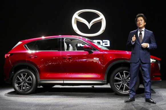 Masahiro Moro, President and CEO of Mazda North America, introduces the 2017 Mazda CX-5 at the 2016 Los Angeles Auto Show in Los Angeles, California, U.S November 16, 2016.  REUTERS/Lucy Nicholson