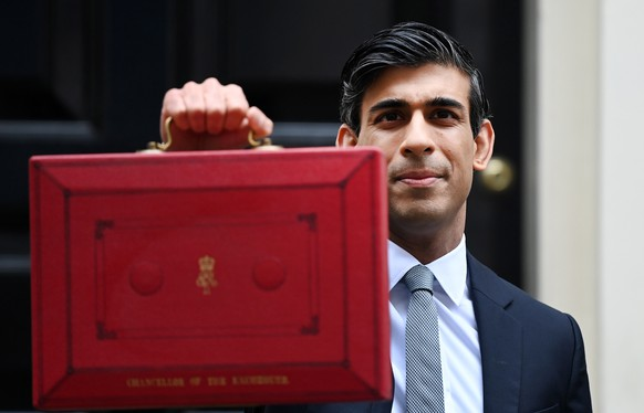 epaselect epa09048226 British Chancellor of the Exchequer Rishi Sunak holds up his budget box ahead of delivering his budget outside 11 Downing Street in London, Britain, 03 March 2021. Sunak is set to announce that the Furlough scheme is set to be extended to September in order to save further job losses.  EPA/ANDY RAIN